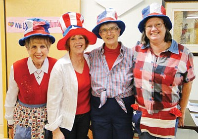 BBNPhoto/Pat Williamson<br> Trish Rasmussen, Anne Canaday, Chris Shackelford, and Karon Trovillion helped organize and serve the Yankee Doodle Luncheon on President's Day.
