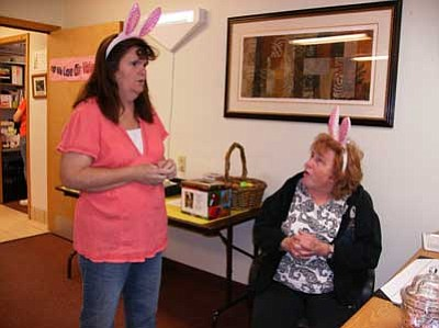 """Courtesy Photo<br /><br /><!-- 1upcrlf2 -->Volunteers Julie Huff, left, and Darlene Nicol wear their """"bunny ears"""" during the Meals on Wheels Easter Brunch Sunday."""