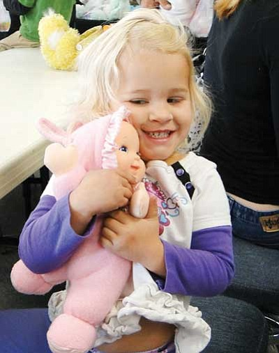 BBNPhoto/Pat Williamson<br> McKenna Wallace holds tight to the doll she won as a prize during the Cordes Lakes Community Association's Easter egg hunt this past Saturday.