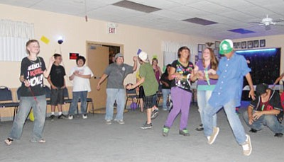 Teens fill the floor during a dance.