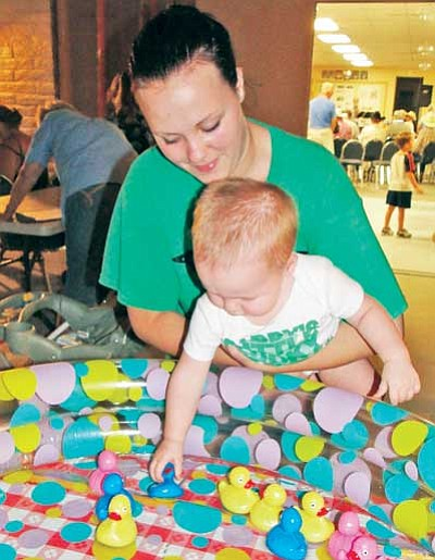 BBNPhoto/Pat Williamson<br>Kole Shellenbarger, with mom Kate, had eyes only for the rubber duckies during the Cordes Lakes Jam Session Saturday night at the Cordes Lakes Community Center.
