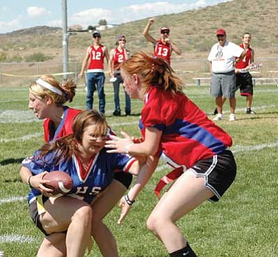 FilePhoto/Cheryl Hartz<br /><br /><!-- 1upcrlf2 -->Homecoming Powder Puff football at Mayer High is anything but soft, as these girls proved in 2011.