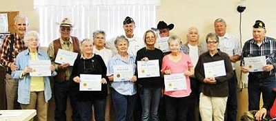 American Legion Post 122 honored volunteers, back row from left, Bob Eaton, Bill Teahon, Val Teahon, Jack Williamson, Chris Swycaffer, Ed Wesolowski, Bill Slankard, Jim Gusenius, and front row,   Alice Eaton, Althea Gavin, Kay Leon, Mary Seppala, Jeanne Wesolowski and Judy Slankard for their help in putting up flags on Cordes Lakes' Avenue of Flags.<BR>  BBNPhoto/Pat Williamson