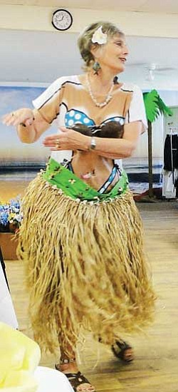 "Sharon Williams performed a hula made hilarious by  ""wardrobe malfunctions"" at the Cordes Lakes Ladies Luncheon<br>BBNPhotos/Pat Williamson"