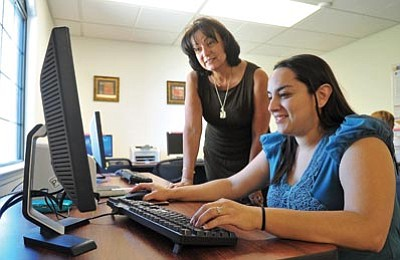 Matt Hinshaw/The Daily Courier/Courtesy<BR>Northern Arizona Council of Governments Regional Director Teri Drew works with Beth Tom on filling out her paperwork for job training classes she will be attending in Colorado, Tuesday afternoon in Prescott.