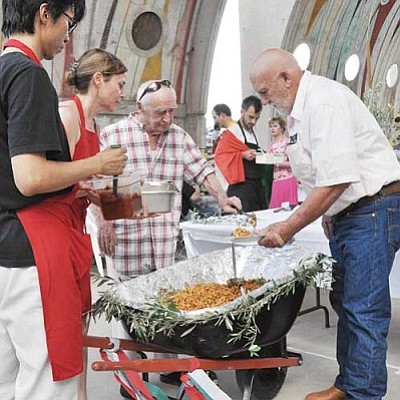 BBNFile/Heidi Dahms Foster<br>Guests will miss Paolo Soleri, shown here at the 2011 Italian Night, serving pasta from a wheelbarrow. But this year's Italian Night will serve up plenty of tributes to the renowned architect.