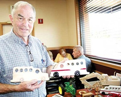 Ed Harrison, founder of the Yavapai Toy Makers, holds the new Hotshot buggy designed by two members, Jake Naujakes ofChino Valley and Bill Curry, Mayer, at an Aug. 20 meeting at the Golden Corral restaurant.<br /><br /><!-- 1upcrlf2 -->
