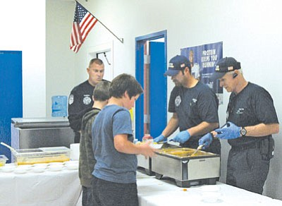 Firefighters from  Mayer Fire Department were on hand last week to serve a traditional Thanksgiving meal to students, parents and guests at Mayer Elementary School. From left are: Brian Simington, Cpt. Jason LaGreca and Paul Coe. See story on Page 6.<br> BBNPhoto/Briana Lonas