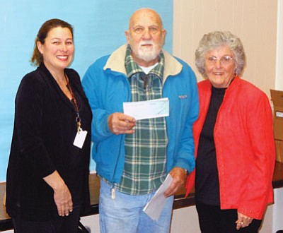 Ben Satran, center, president of the Arizona Highway 69 Chamber of Commerce presents a check to Tami Hitt-Wyant, director of Food and Nutrition for Humboldt Unified School District, left, and Carm Staker, Hungry Kids Project coordinator, right.