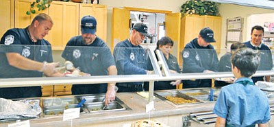 Mayer Fire firefighters and staff serve Thanksgiving dinner in 2013 with Mayer Area Meals on Wheels. The Meals on Wheels Spaghetti Dinner is held at 10051 S. Miami, on the third Sunday of every month. (Pat Williamson/Courtesy, file photo)