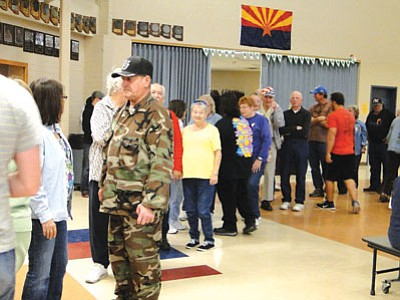 Hungry folks line up for a free Thanksgiving feast at Mayer High School.<br> BBN/Pat Williamson