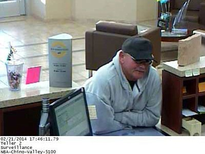 Bank video footage shows the robbery suspect believed to be Kevin Lee Campbell, who is described as a white man, 5-foot-10 with grey hair and green eyes. He was last seen wearing a hooded sweatshirt, blue jeans, a dark colored ball hat and sunglasses.<br> Courtesy photo