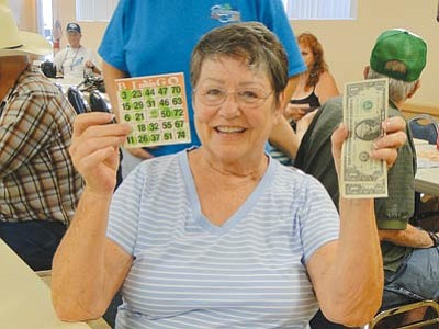 Flo Lottes was the first winner on Aug. 13 during the Cordes Lakes Community Association's premiere Bingo session. (Pat Williamson/Courtesy photo)