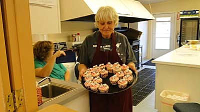 Pat Williamson/BBN<br /><br /><!-- 1upcrlf2 -->Pam Davis with dice cupcakes.