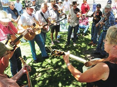 Over the weekend of June 27-28, musicians will not be seen only on stage ... as part of the annual Prescott Bluegrass Festival on the courthouse plaza. Though, the bands that are coming are not to be missed! (Les Stukenberg/The Daily Courier, file)
