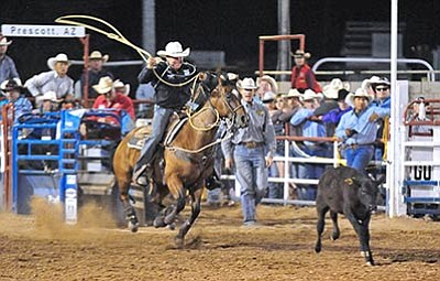 Matt Hinshaw/The Daily Courier<br /><br /><!-- 1upcrlf2 --><br /><br /><!-- 1upcrlf2 -->Trevor Brazile of Decatur, Texas, competes in tie-down roping at the Prescott Frontier Days' World's Oldest Rodeo on July 2, 2014.