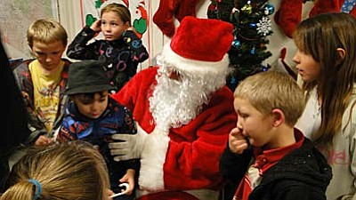 Pat Williamson photo<br /><br /><!-- 1upcrlf2 -->Santa visits with the children.