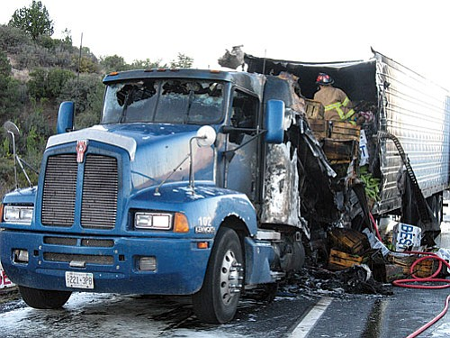 Courtesy photo<br> The burned truck was reportedly carrying produce from California.