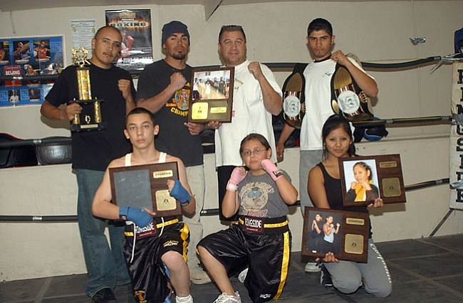 VVN/Wendy Phillippe The Golden Cobra Center of Fitness Inc. boxing and kickboxing team. (L-r) Juan Munoz, Clifford Larson, Richard Williams, Victor Romero, Alex Montano, Yasi Montano and Amanda Honwytewa pose with their awards.