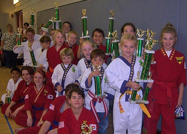 Courtesy Photo The KC's Family Tae Kwon Do team with trophies.