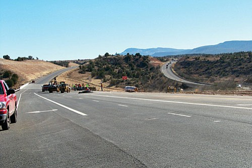 VVN/Jon Hutchinson<br> Ames Construction crews finish touch-up work before the new SR 260 section opened Friday.