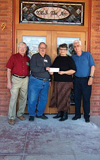 Knights Lend a Hand The Knights of Columbus Verde Council 2493 presented a check for over $3300 to YE.S. The Arc Feb. 24. Another $1000 went to the Arizona Special Olympics. The monies were collected during the Knight's annual Tootsie Roll Drive. The drive was held with the cooperation of several Verde Valley grocers: Bashas, Food City, Fry's and Safeway. Pictured is Deputy Grand Knight Chuck Bismack, drive chairman Gary Lamm, Penny Vigil Executive Director of Y.E.S The Arc, and Grand Knight Jeff Leonard. Leonard expressed an appreciation to the generous people of Verde Valley who helped make this effort successful.