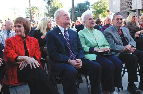 Capitol Media Services file photo<br> Fife Symington, center, was one of four former governors in attendance in January when Jan Brewer was sworn in as governor. Now Symington said Brewer is doing a bad job and is weighing running against her in next year's Republican primary. With Symington are Jane Hull, left, a Republican, and Democrats Rose Mofford and Raul Castro.
