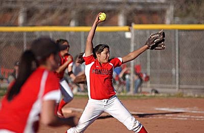 Freshman Angelina Saucedo pitches in the final inning of the Monday game against Prescott.