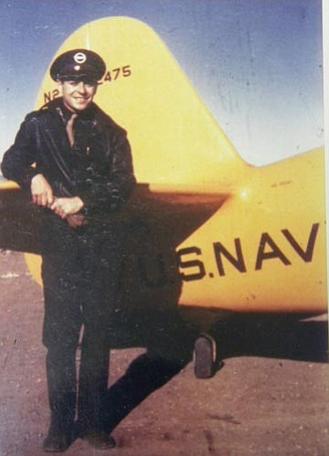 A flight student with the Yellow Peril, N3N, at Clemenceau.