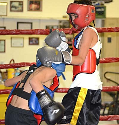 <b>Javier</b> and <b>Mardquez Mestas</b> spar in training Monday at the Golden Cobra Gym. VVN/Sean Morris