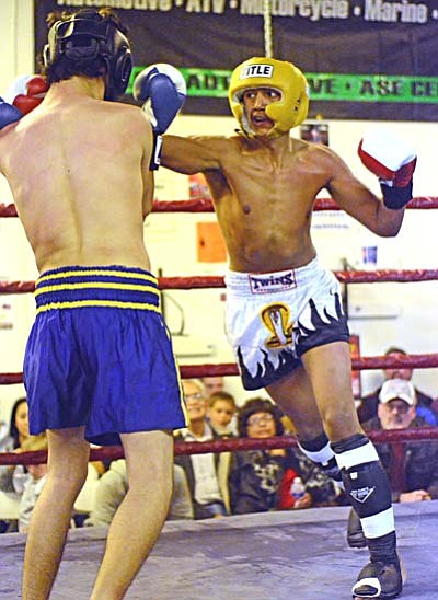 <b>Jesse Duran</b> fights against <b>Christian Lopez</b> in the semi-main event Saturday evening at Golden Cobra Gym. VVN/Sean Morris