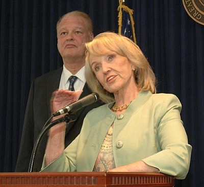 Gov. Jan Brewer explains why she has directed Attorney General Tom Horne to ask a federal court to decide if Arizona can enforce its new medical marijuana law despite federal statutes making possession, sale and transportation of the drug illegal.  (Capitol Media Services photo by Howard Fischer)