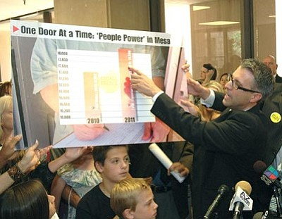 Randy Parraz, one of the organizers of the recall of Senate President Russell Pearce, details the number of signatures received. Parraz said more people signed the recall than voted for Pearce last year. (Capitol Media Services photo by Howard Fischer)