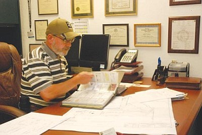 VVN/Steve Ayers<br> A down economy has created a new kind of workload for Camp Verde's Community Development Department that keep staff just as busy without the usual revenue stream.