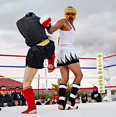 <b>Jesse Duran</b> lands a spinning back fist in a Muay Thai match against J.J. Kim Saturday afternoon on Main St. in Cottonwood. VVN/Sean Morris