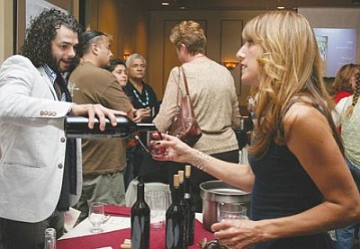 VVN/Steve Ayers<br> More than 100 people showed up last Saturday at the Hotel at Cliff Castle for the valley's first Verde Valley Wine Symposium. Although all the planned events were sold out, most people showed up for the wine tasting and barrel auction, which raised more than $10,000.
