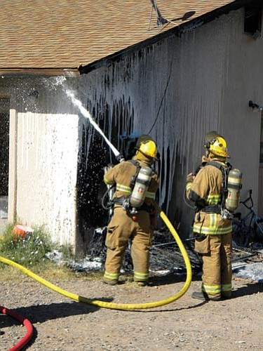 VVN/Jon Hutchinson<br> A fire at a home on 10th Street in Cottonwood brought out firefighters and made the house uninhabitable until power can be restored. The cause is under investigation.