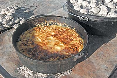 VVN/Steve Ayers<br /><br /><!-- 1upcrlf2 -->With every Dutch oven meal there is always at least one oven with a simmering batch of cobbler or other desert setting by the fire.
