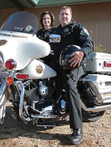 Camp Verde Marshal Nancy Gardner with newly promoted motorcycle officer Russell Grover.