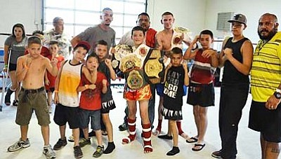 The mini-cobras stand with the two champions that were crowned at Golden Cobra's Down and Dirty III. VVN/Travis Guy