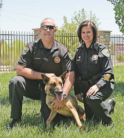 Deputy Jeff Bowers and Marshal Nancy Gardner of the Camp Verde Marshal's Office, with Claymore, the CVMO's newest K9 officer. VVN/Bill Helm