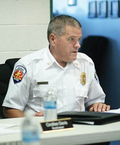 VVN/Bill Helm<br> MRFD Fire Chief Terry Keller discusses the district's 2013-14 budget with MRFD board members during Thursday's public meeting.