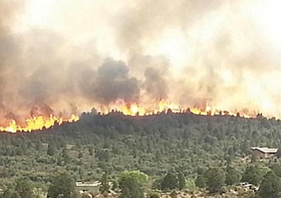 Courtesy photo<br> The Yarnell Hill Fire spread quickly to 8,400 acres and took the lives of 19 firefighters on Sunday.