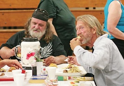"Camp Verde residents Clyde Sexton and Timothy Shepard, from left, enjoy a hot meal, courtesy of Bread of Life. ""I come here to eat good food, and I can eat some spiritual food,"" Shepard says. VVN/Bill Helm"