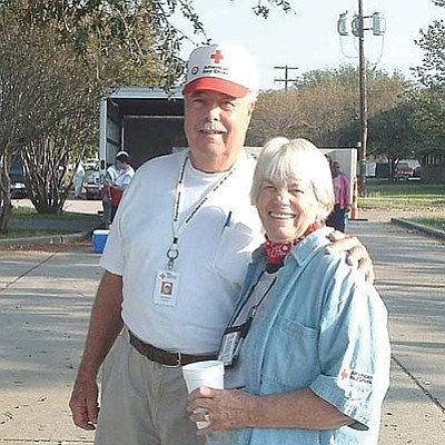 """Bob and Helen Zimmerli take a break from disaster relief duties in Biloxi Mississippi, 2007, during Rita, the storm following Hurricane Katrina. According to Bob, it was """"much worse than New Orleans. All the ERVs ended up in Biloxi. This trip culminated in feeding about 16,000 eight-course Thanksgiving dinners in Biloxi, door-to-door. Courtesy photo.<br /><br /><!-- 1upcrlf2 -->"""