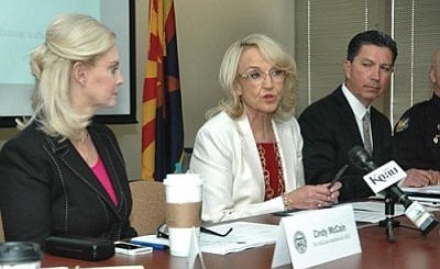 Flanked by Cindy McCain and Gil Orrantia, who she chose to chair a panel to combat human sex trafficking, Gov. Jan Brewer called it an ``unthinkable, evil, sick practice.' But the governor later said her desire to help victims of this crime is totally unrelated to her decision to expand the list of who doesn't get driver's licenses to victims of domestic violence in this country illegally. (Capitol Media Services photo by Howard Fischer)