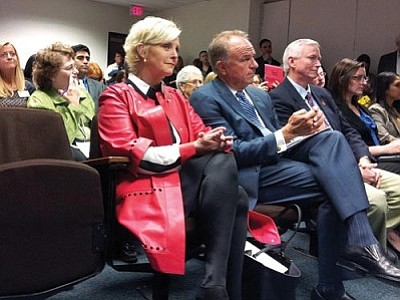 Cindy McCain and former Arizona Attorney General Grant Woods, to her left, are both members of a task force Gov. Jan Brewer assembled to recommend responses to human trafficking in Arizona. (Cronkite News Service Photo by Jordan Young)