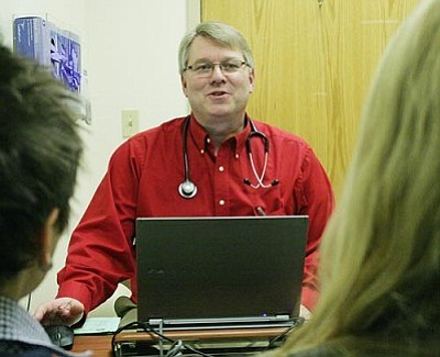 """We can take care of a patient's health care with the computer,"" says John Rooney, D.O. at the Verde Valley Medical Clinic – Primary Care, a service of Verde Valley Medical Center. ""But nothing beats hands-on care."" VVN/Bill Helm"
