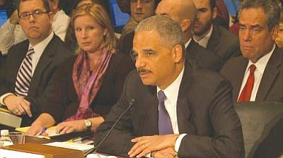 Attorney General Eric Holder, here in a 2012 photo, said the Justice Department will treat legal same-sex marriages the same as any other marriage in cases handled by the agency, even if it is in a state – like Arizona – where such marriages are not recognized. (Cronkite News Service photo by Nathan O'Neal)