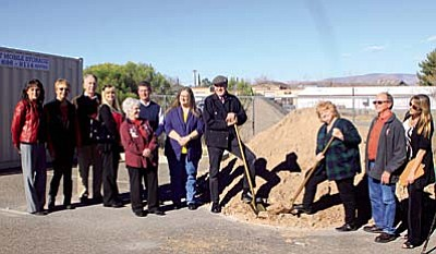 Senior Center Director Elaine Bremner and Sam Blom wield golden shovels to turn earth. Also (l-r) are Lana Tolleson, Linda Norman, Dennis Tomko, Andrea Harless, Councilwoman  and Casey Rooney of Economic Development, Councilwoman Karen Pfeifer, Blom. With Bremner on right are Doug Stroh and Isabel Rollins. Courtesy Beach's on Location